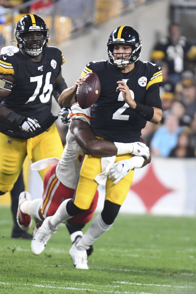 Pittsburgh Steelers quarterback Mason Rudolph (2) is hit as he plays against the Kansas City Chiefs in the first half of a preseason NFL football game, Saturday, Aug. 17, 2019, in Pittsburgh. (AP Photo/Barry Reeger)