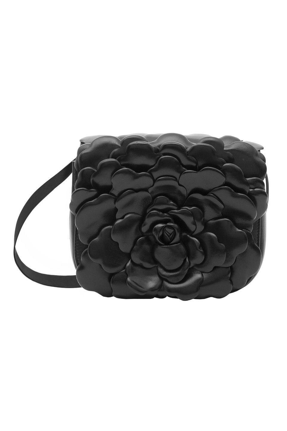 "<p>In search for a non-boring black bag? Look no further than Valentino's freshest bloom, the Petal bag. The style is only available in select retailers right now, so keep an eye on it before it sells out. </p><p><em>Valentino Garavani Atelier Petal, $2,995; valentino.com</em></p><p><a class=""link rapid-noclick-resp"" href=""https://www.valentino.com/en-us"" rel=""nofollow noopener"" target=""_blank"" data-ylk=""slk:SHOP NOW"">SHOP NOW</a></p>"