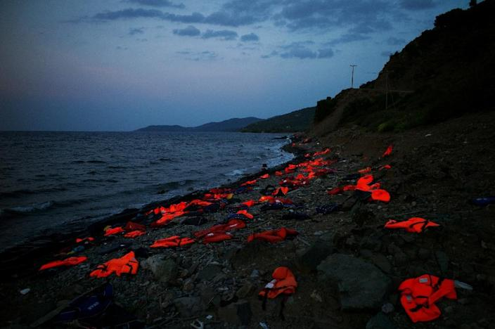 This photo taken on September 8, 2015 on the Greek island of Lesbos shows life vests left on the shore by incoming refugees (AFP Photo/Angelos Tzortzinis)