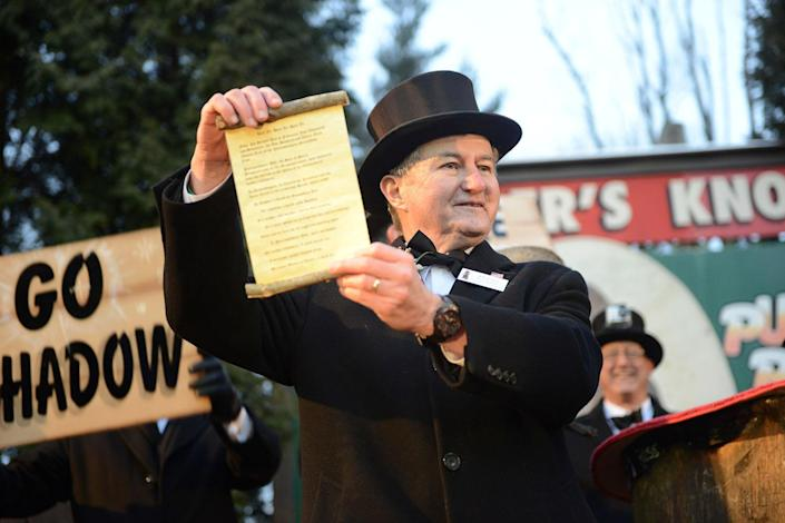 <p>Groundhog Club Inner Circle member Jeff Lundy holds a scroll with Punxsutawney Phil's forecast at Gobbler's Knob on the 131st Groundhog Day in Punxsutawney, Pa., Feb. 2, 2017. (REUTERS/Alan Freed) </p>