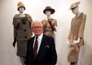 "FILE PHOTO: French fashion designer Pierre Cardin poses in front of his fashion creations in his museum called ""Past-Present-Future"" in Paris"