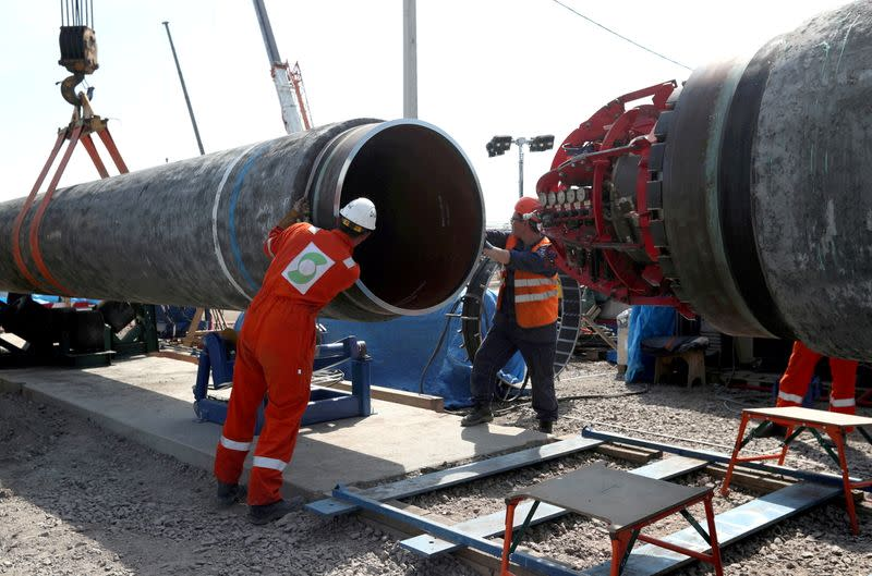 FILE PHOTO: Workers are seen at the construction site of the Nord Stream 2 gas pipeline, near the city of Kingisepp, Russia