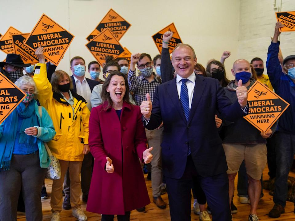 Liberal Democrat leader Ed Davey and Sarah Green, the party's new MP for Chesham and Amersham, celebrate her by-election victory on Friday (PA)