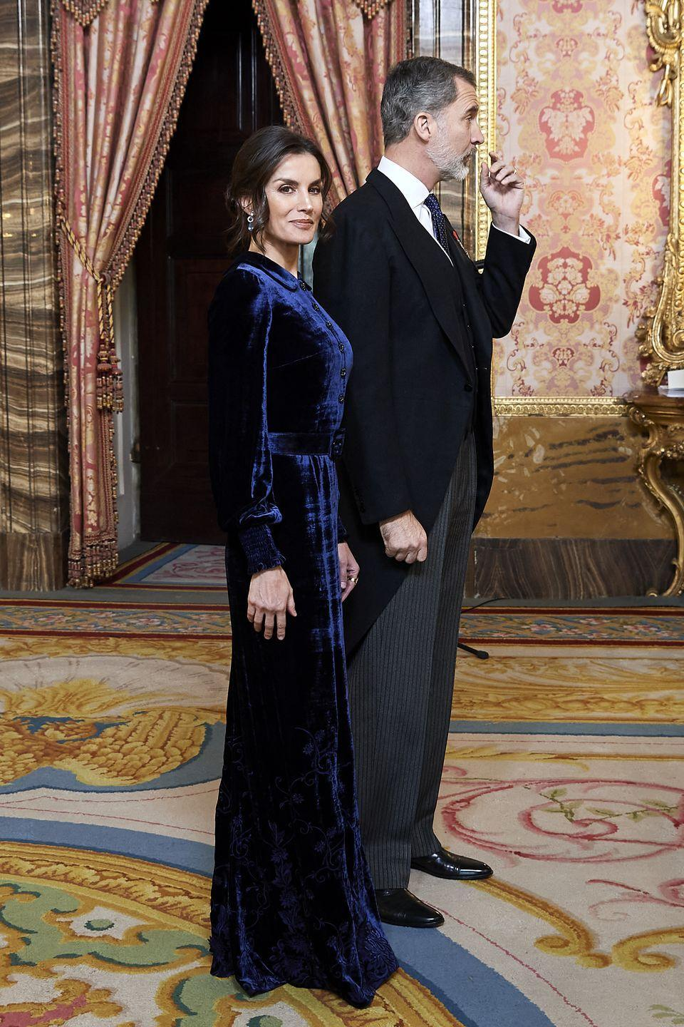 <p>Letizia stunned in this Felipe Varela floor-length, blue velvet gown. She wore the look to receive the Diplomatic Corps at Madrid's Zarzuela Palace.</p>