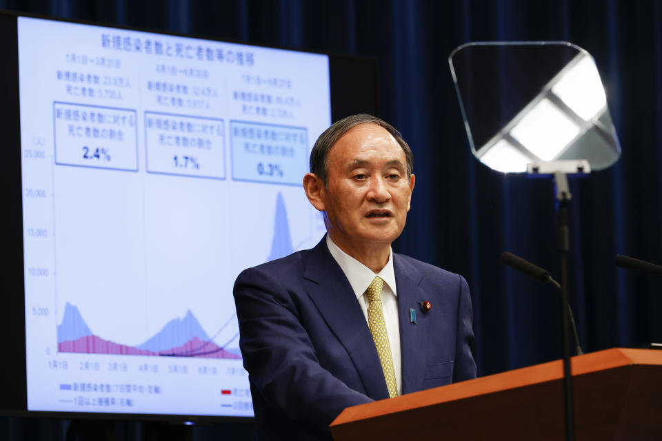 Japan's Prime Minister Yoshihide Suga speaks during a press conference at the prime minister's official residence on Tuesday, Sept. 28, 2021, in Tokyo. Suga announced the coronavirus state of emergency will end Thursday so the economy can be reactivated as infections slow. (Rodrigo Reyes Marin/Pool Photo via AP)