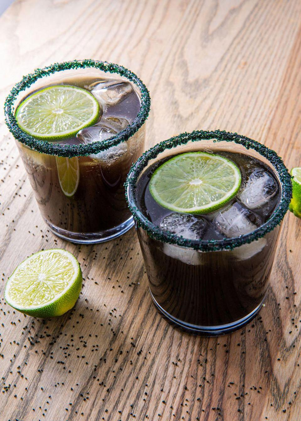 "<p>Let's get witch-faced.</p><p>Get the recipe from <a href=""https://www.delish.com/cooking/recipe-ideas/recipes/a55953/black-magic-margaritas-recipe/"" rel=""nofollow noopener"" target=""_blank"" data-ylk=""slk:Delish"" class=""link rapid-noclick-resp"">Delish</a>. </p>"