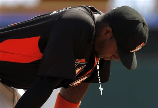 Miami Marlins third baseman Hanley Ramirez leans over between plays in the fifth inning of a spring training baseball game against the Atlanta Braves in Kissimmee, Fla., Thursday, March 22, 2012. (AP Photo/Paul Sancya)
