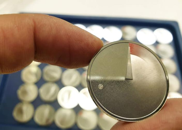 A man shows 5 Euros nominal silver coins, minted to mark the coronavirus disease (COVID-19) outbreak in Vilnius