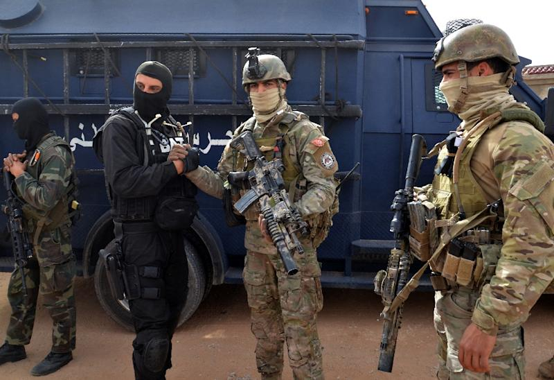 Tunisian special forces, like these pictured on March 21, 2016, have dismantled two Al-Qaeda-linked terrorist cells that were planning to carry out attacks against shopping malls and political parties