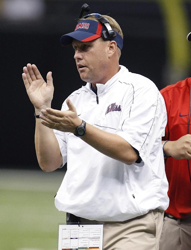 FILE - In this Sept. 22, 2012 file photo, Mississippi head coach Hugh Freeze applauds his team in the first half of an NCAA college football game against Tulane in New Orleans. Freeze says he grabbed his phone on Sunday for one final text exchange with Auburn coach Gus Malzahn. The gist of the conversation: It's hard playing against friends, so we'll talk when this is over. Mississippi plays Auburn Saturday, Oct. 5 at Auburn. (AP Photo/Bill Haber, File)