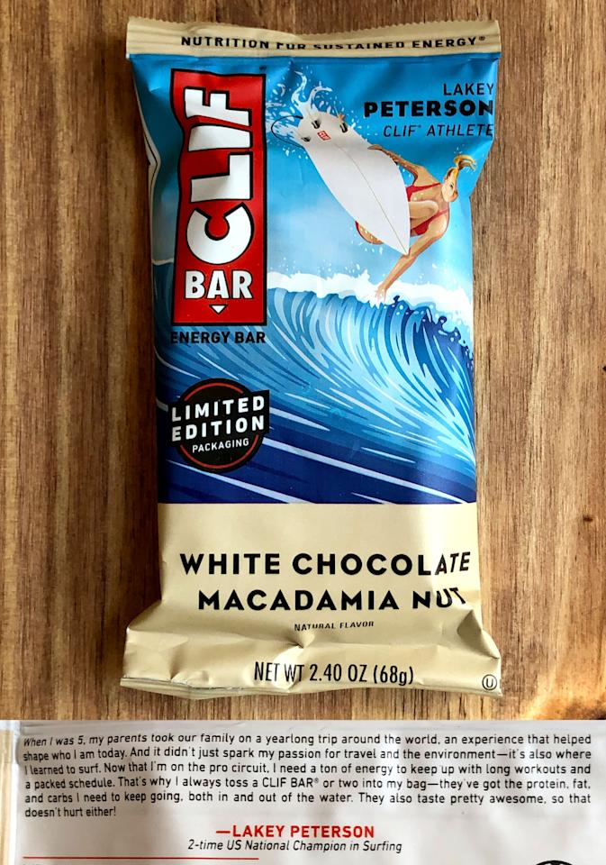 """<p>Probably my all-time favorite flavor, White Chocolate Macadamia Nut will now feature two-time US National Surfing Champion <a href=""""https://www.popsugar.com/fitness/surfer-lakey-peterson-interview-body-positivity-46669586"""" class=""""ga-track"""" data-ga-category=""""Related"""" data-ga-label=""""https://www.popsugar.com/fitness/surfer-lakey-peterson-interview-body-positivity-46669586"""" data-ga-action=""""In-Line Links"""">Lakey Peterson</a>. In the quote on the back of the bar, she talked about how her parents took her on a trip around the world when she was just 5 years old, and that's when she learned to surf.</p>"""