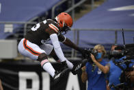 Cleveland Browns tight end David Njoku (85) jumps after scoring a touchdown, during the first half of an NFL football game against the Baltimore Ravens, Sunday, Sept. 13, 2020, in Baltimore, MD. (AP Photo/Nick Wass)