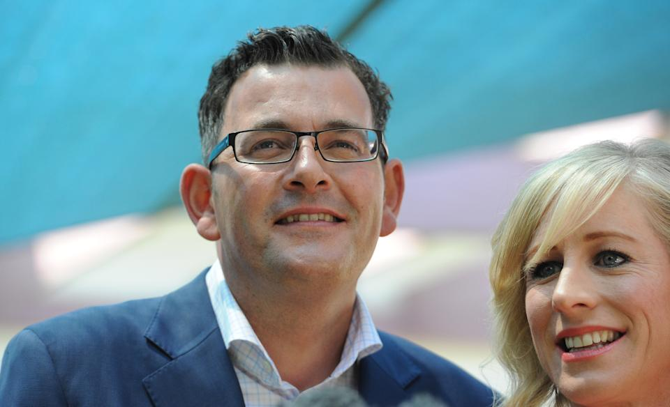 Victorian opposition leader Daniel Andrews (left) and Cath Andrews campaign at Godfrey Street Community House in Bentleigh in Melbourne, Friday, Nov. 28, 2014. Victoria goes to the polls in a state election tomorrow. (AAP Image/Julian Smith) NO ARCHIVING