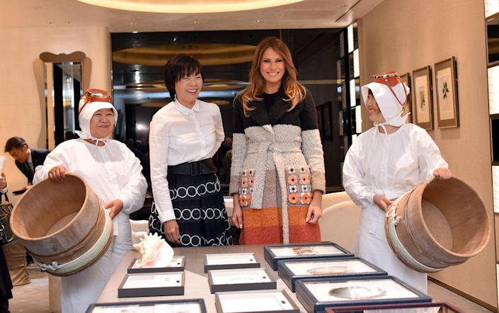 <p>First Lady Melania Trump (C-R), Japanese First Lady Akie Abe (C-L) and Ama divers visit the Mikimoto Pearl head shop in Ginza district of Tokyo on November 5, 2017. (Photo: Katsumi Kasahara/AFP/Getty Images) </p>