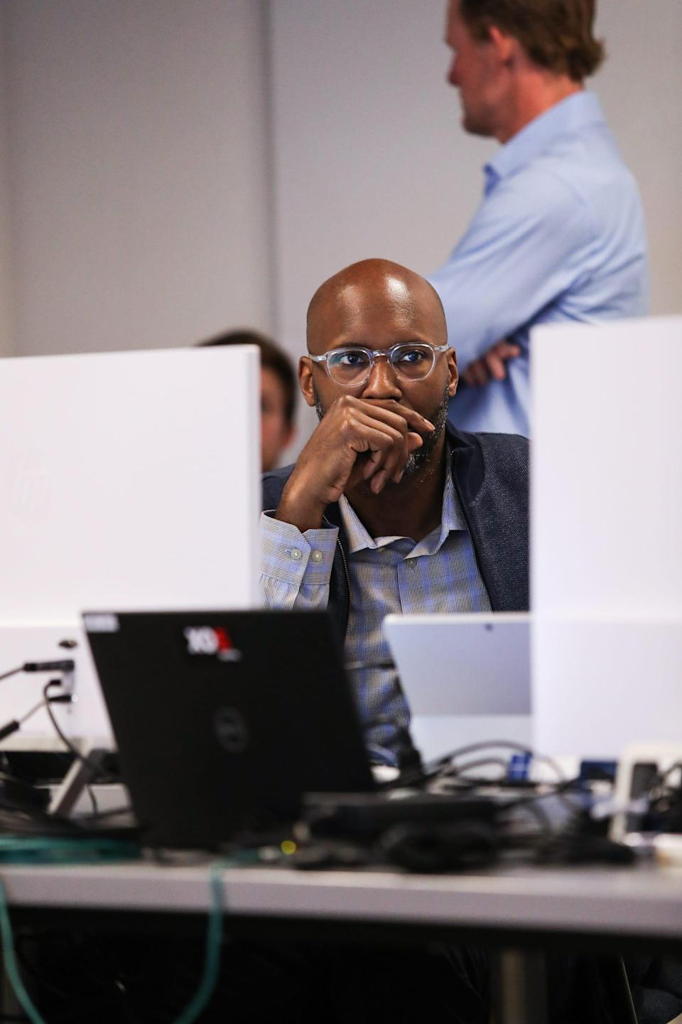 Brad Holmes ponders the draft board during Day 2 of the 2019 NFL draft in Agoura Hills, California, on Friday, April 26, 2019.