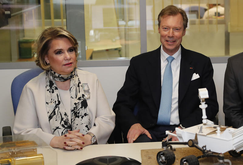 Grand Duke Henri of Luxembourg and Grand Duchess Maria-Teresa of Luxembourg attend a visit at the National Centre for Space Studies (CNES) in Toulouse, southwestern France, Wednesday March 21 2018. (Guillaume Horcajuelo, Pool via AP)