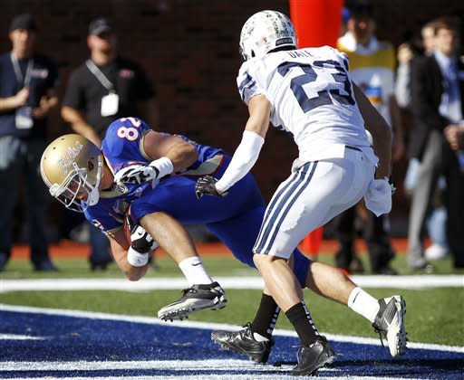 Tulsa tight end Clay Sears (82) lunges past BYU defensive back Travis Uale (23) for a touchdown during the second quarter of the Armed Forces Bowl NCAA college football game on Friday, Dec. 30, 2011, in Dallas. (AP Photo/John F. Rhodes)