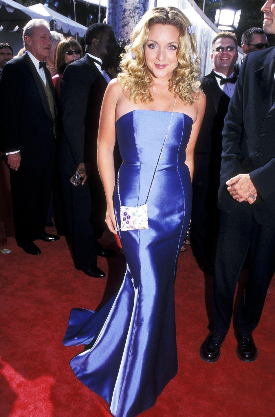 <p>Krakowski wore this very fitted (and very shiny) blue gown to the Emmy Awards in 1999.</p>