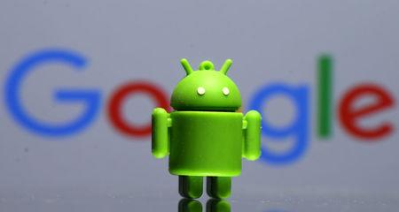 FILE PHOTO: A 3D printed Android mascot in front of a Google logo