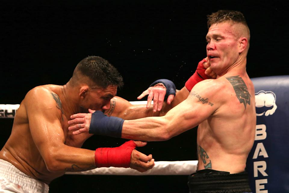 TAMPA, FL - JUNE 22: Joe Riggs (R) and Walber Barros exchange blows during the Bare Knuckle Fighting Championships at Florida State Fairgrounds Entertainment Hall on June 22, 2019 in Tampa, Florida. (Photo by Alex Menendez/Getty Images)