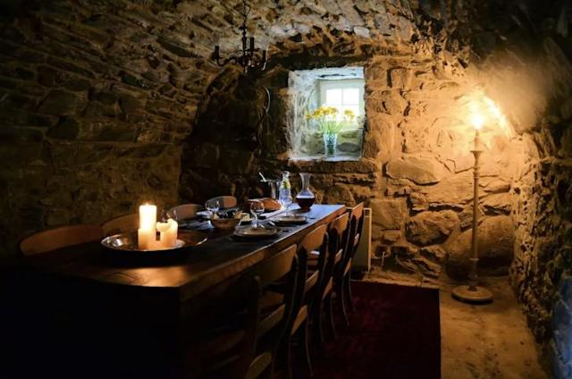 """<p>The dining room looks straight out of """"Game of Thrones."""" </p>"""