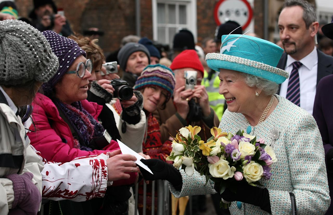 NORFOLK, ENGLAND - FEBRUARY 6: Queen Elizabeth II is greeted by wellwishers during a visit to Kings Lynn Town Hall on February 6, 2012 in Norfolk, England. Today is Accession Day, with the Queen celebrating 60 years to the day since she became Monarch. (Photo by Chris Radburn - WPA Pool/Getty Images)