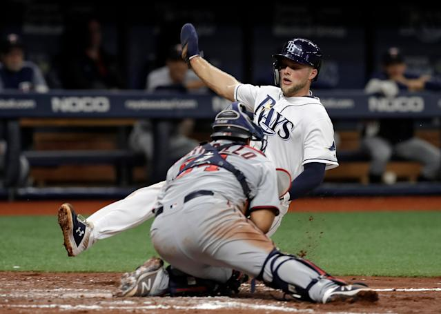 Tampa Bay Rays' Austin Meadows steals home ahead of the tag by Minnesota Twins catcher Willians Astudillo during the third inning of a baseball game Friday, May 31, 2019, in St. Petersburg, Fla. (AP Photo/Chris O'Meara)