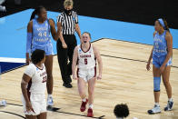 Alabama guard Hannah Barber, center, celebrates in front of North Carolina center Janelle Bailey (44) and guard Stephanie Watts, right, during the second half of a college basketball game in the first round of the women's NCAA tournament at the Alamodome in San Antonio, Monday, March 22, 2021. (AP Photo/Eric Gay)