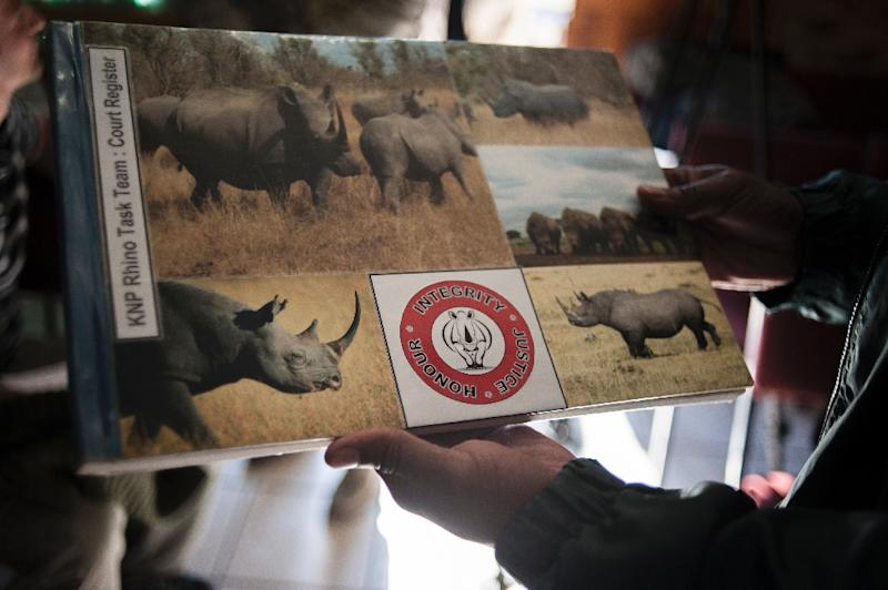 The register book for the Kruger National Park Rhino Task Team is seen at the Skukuza courthouse on June 24, 2015 (AFP Photo/Stefan Heunis)