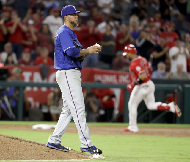 Los Angeles Angels' Jose Fernandez, right, rounds the bases after a two-run home run off Texas Rangers starting pitcher Yovani Gallardo during the third inning of a baseball game in Anaheim, Calif., Wednesday, Sept. 12, 2018. (AP Photo/Chris Carlson)
