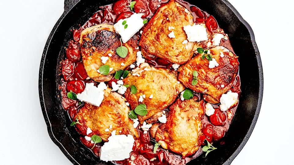 """This one-skillet dish is everything we want in an easy chicken dinner: It has super-crispy skin on top and tender, juicy meat underneath. <a href=""""https://www.epicurious.com/recipes/food/views/chicken-thighs-with-tomatoes-and-feta?mbid=synd_yahoo_rss"""" rel=""""nofollow noopener"""" target=""""_blank"""" data-ylk=""""slk:See recipe."""" class=""""link rapid-noclick-resp"""">See recipe.</a>"""