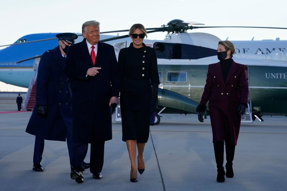 Outgoing US President Donald Trump and First Lady Melania Trump(C) walk from Marine One at Joint Base Andrews in Maryland on January 20, 2021. - President Trump travels his Mar-a-Lago golf club residence in Palm Beach, Florida, and will not attend the inauguration for President-elect Joe Biden. (Photo by ALEX EDELMAN / AFP) (Photo by ALEX EDELMAN/AFP via Getty Images)