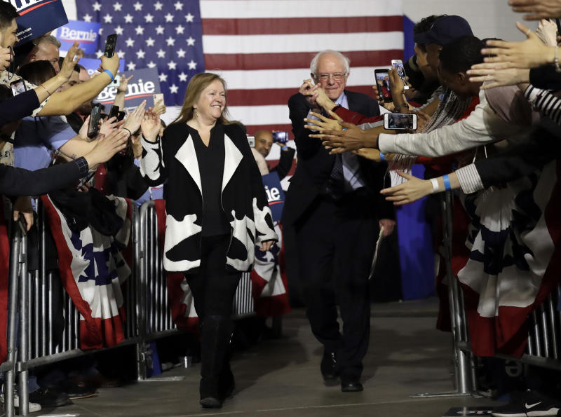 FILE - In this March 3, 2019, file photo, Sen. Bernie Sanders, I-Vt., right, and his wife Jane Sanders, greet supporters as they arrive arrive for a campaign event at Navy Pier in Chicago. Bernie Sanders' revolution is Jane Sanders' career. And her political and business activities have at times been his headache. His closest adviser, she is perhaps the most influential woman in the 2020 campaign who isn't a candidate. (AP Photo/Nam Y. Huh, File)