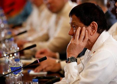 FILE PHOTO - President Rodrigo Duterte gestures during a bilateral meeting with Chinese Premier Li Keqiang at Malacanang Palace in metro Manila