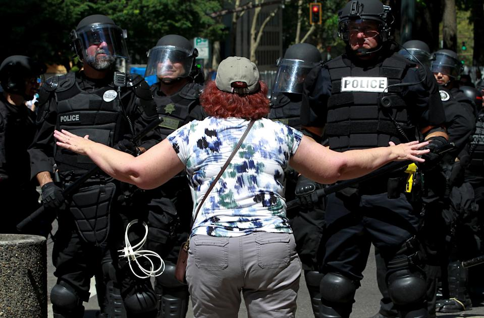 <p>A counterprotester argues with police during a rally by the Patriot Prayer group in Portland, Ore., Aug. 4, 2018. (Photo: Bob Strong/Reuters) </p>
