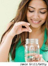Woman puts coins in a jar