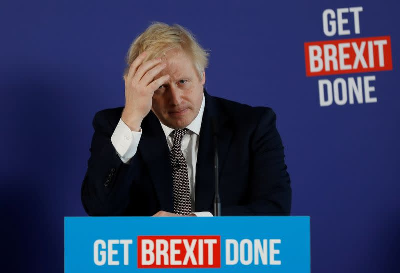 Britain's Prime Minister Boris Johnson and Chancellor of the Duchy of Lancaster Michael Gove hold a joint news conference