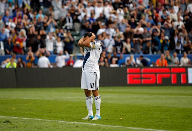 Los Angeles Galaxy's Landon Donovan reacts after missing a shot during the first half of the MLS Cup championship soccer match against the Houston Dynamo in Carson, Calif., Saturday, Dec. 1, 2012. (AP Photo/Jae C. Hong)