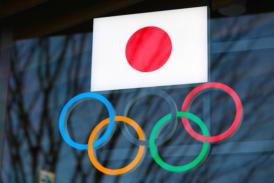 TOKYO, JAPAN - 2021/03/15: Japanese flag with Olympic Rings above the entrance to Japan Olympic Museum in Shinjuku. Due to the Coronavirus pandemic, the Tokyo 2020 Olympic Games were moved to be held between 7.23 - 8.8, 2021. (Photo by Stanislav Kogiku/SOPA Images/LightRocket via Getty Images)