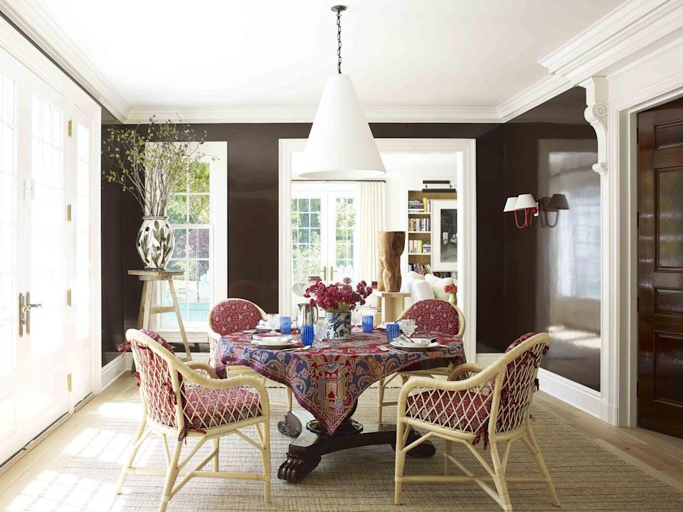 """<p>The light-filled dining room of <a href=""""https://www.veranda.com/decorating-ideas/house-tours/a32721440/david-netto-connecticut-house/"""" rel=""""nofollow noopener"""" target=""""_blank"""" data-ylk=""""slk:this Connecticut house"""" class=""""link rapid-noclick-resp"""">this Connecticut house</a> designed by David Netto features walls painted with Tanner's Brown (<a href=""""https://go.redirectingat.com?id=74968X1596630&url=https%3A%2F%2Fwww.farrow-ball.com%2Fen-us&sref=https%3A%2F%2Fwww.veranda.com%2Fdecorating-ideas%2Fcolor-ideas%2Fg34859300%2Fbrown-paint-colors%2F"""" rel=""""nofollow noopener"""" target=""""_blank"""" data-ylk=""""slk:Farrow & Ball"""" class=""""link rapid-noclick-resp"""">Farrow & Ball</a>) in full gloss. Plaster cone hanging light, <a href=""""https://www.roseuniacke.com/"""" rel=""""nofollow noopener"""" target=""""_blank"""" data-ylk=""""slk:Rose Uniacke"""" class=""""link rapid-noclick-resp"""">Rose Uniacke</a></p><p><a class=""""link rapid-noclick-resp"""" href=""""https://go.redirectingat.com?id=74968X1596630&url=https%3A%2F%2Fwww.farrow-ball.com%2Fen-us%2Fpaint-colours%2Ftanners-brown&sref=https%3A%2F%2Fwww.veranda.com%2Fdecorating-ideas%2Fcolor-ideas%2Fg34859300%2Fbrown-paint-colors%2F"""" rel=""""nofollow noopener"""" target=""""_blank"""" data-ylk=""""slk:Get the Look"""">Get the Look</a></p>"""