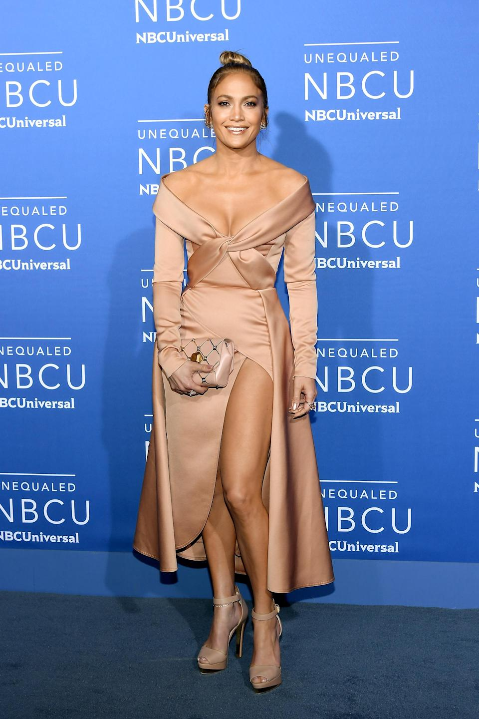 <p>A different look for J.Lo, this midi gown paid perfect homage to all of her hard work over the years, giving a glimpse of her athletic physique. [Photo: Getty] </p>