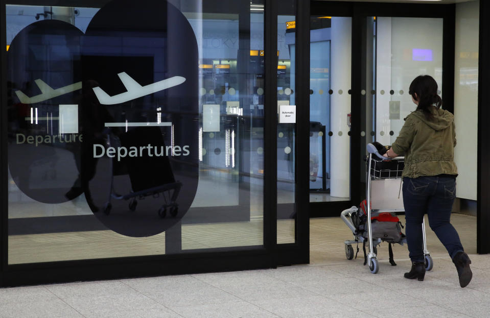 A passenger enters departures in Terminal 2 at Heathrow Airport in London. Photo: Luke MacGregor/Reuters