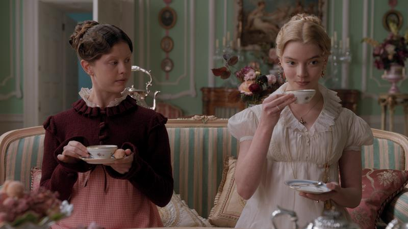 Mia Goth's Harriet Smith and Anya Taylor-Joy's Emma Woodhouse take tea in a still from Emma. (Photo: Focus Features)