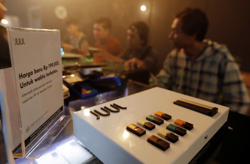 Juul brand vaping products are seen promoted at a vape shop in Jakarta