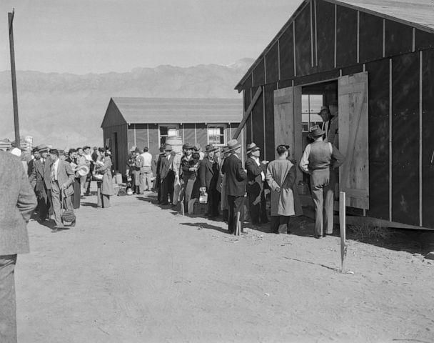 PHOTO: Japanese people lining up for registration at the Alien Reception Center, Manzanar, Calif., March 27, 1942. (Bettmann Archive/Getty Images, FILE)