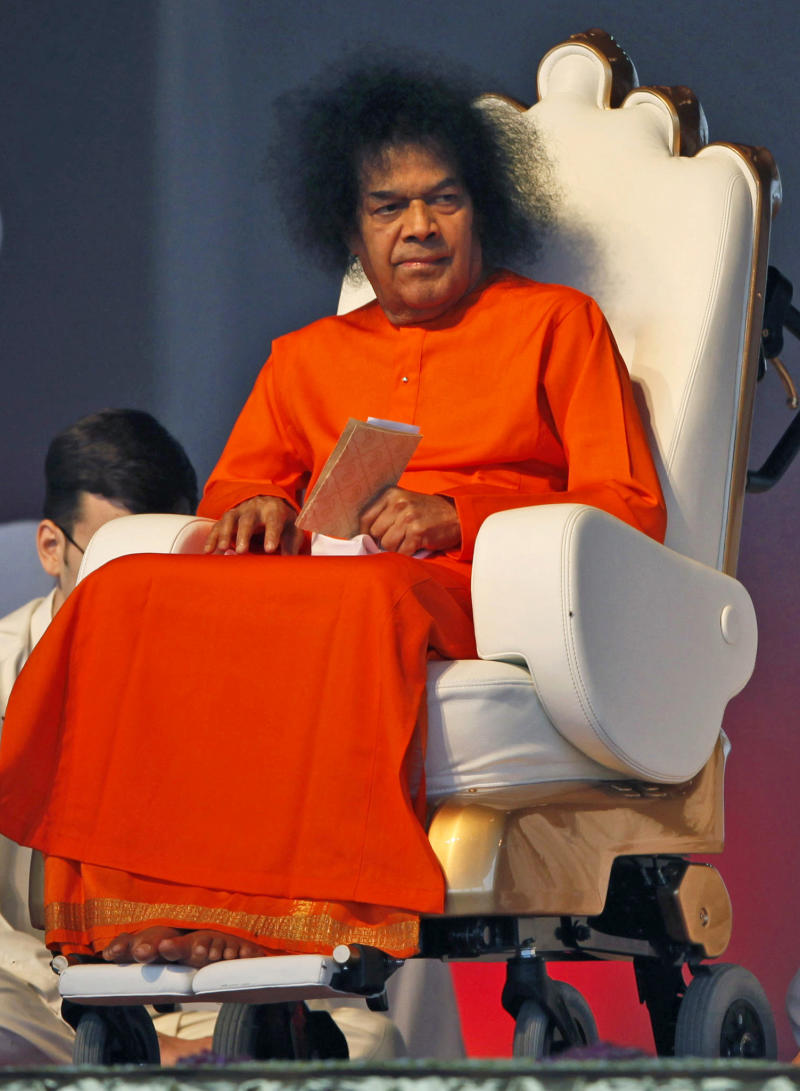 FILE - In this April 10, 2010 file photo, Indian spiritual leader Sathya Sai Baba looks on at a function to meet his devotees in New Delhi.  Dr. A.N. Safaya says Sathya Sai Baba died Sunday morning, April 24, 2011,  after more than a week on breathing support and dialysis at the Sri Sathya Sai Institute of Higher Medical Sciences.  He was 86. (AP Photo/Mustafa Quraishi, File)