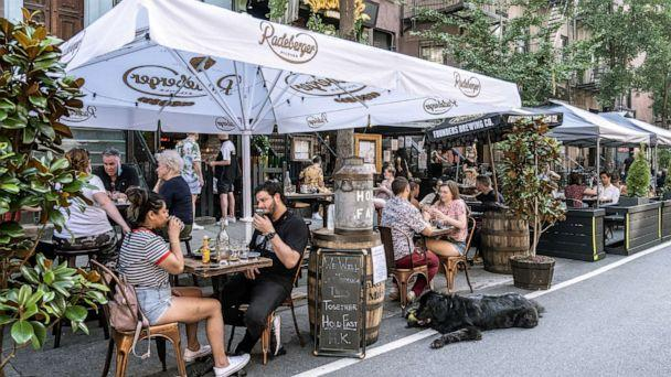 PHOTO: People enjoy al fresco dining at a bar as the coronavirus kept restaurants from offering indoor dining, July 5, 2020, in New York City. (Jeenah Moon/Reuters)
