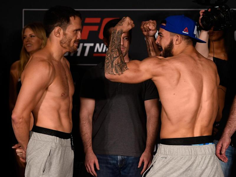 Ellenberger and Perry face off during the UFC Fight Night weigh-in (Getty)