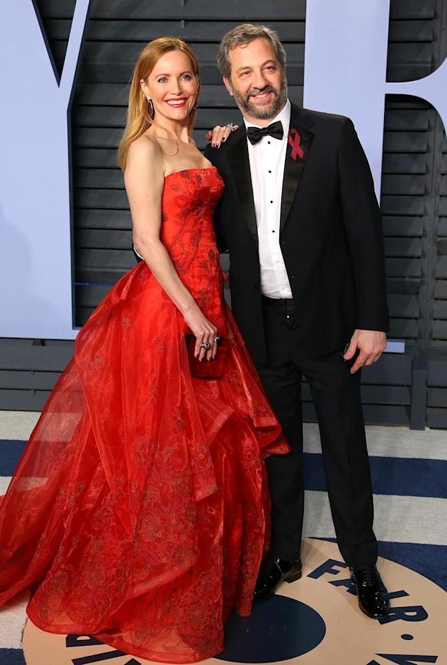 <p>The actress, pictured with her producer husband, was the belle of the ball in her red Zac Posen gown. (Photo: JEAN-BAPTISTE LACROIX/AFP/Getty Images) </p>