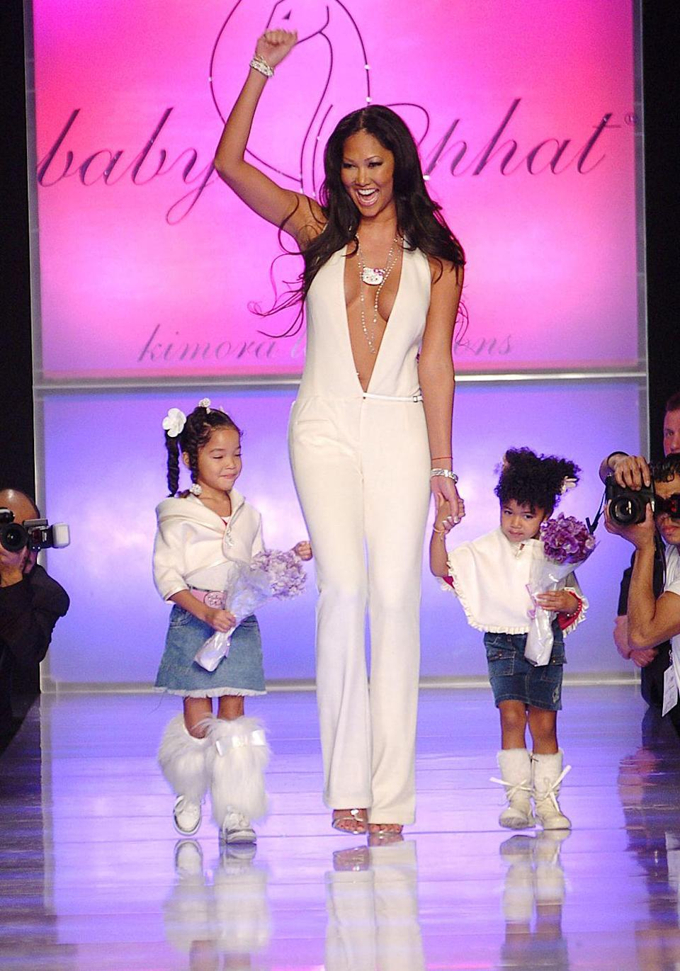 <p>Kimora Lee Simmons brought two very special guests with her for the close of her Baby Phat show in 2005, her daughters Ming Lee and Aoki Lee Simmons. Their adorable outfits only made the moment more memorable, we're sure.</p>